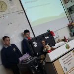 JCA 2 and 3 presenting their Food Miles project to the St Rynaghs N.S. 2nd Class